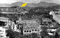 Viewing north across the Tsim Sha Tsui area in 1908, the Observatory building (indicated by an arrow) could be seen standing above the rest at a vantage point ideal for making observations.