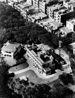 An aerial view of the 1883 Building in 1951 with the No. 1 quarter on the left, and the signal mast and the annex building on the right.