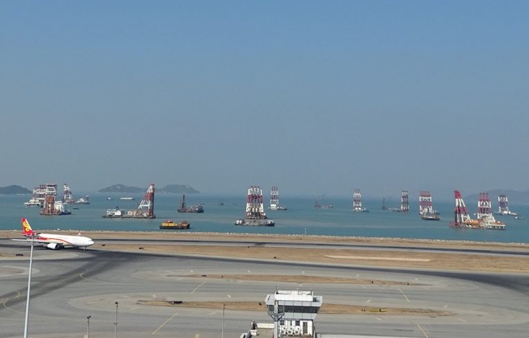 Image showing a large number of construction vessels within the three-runway system works site.