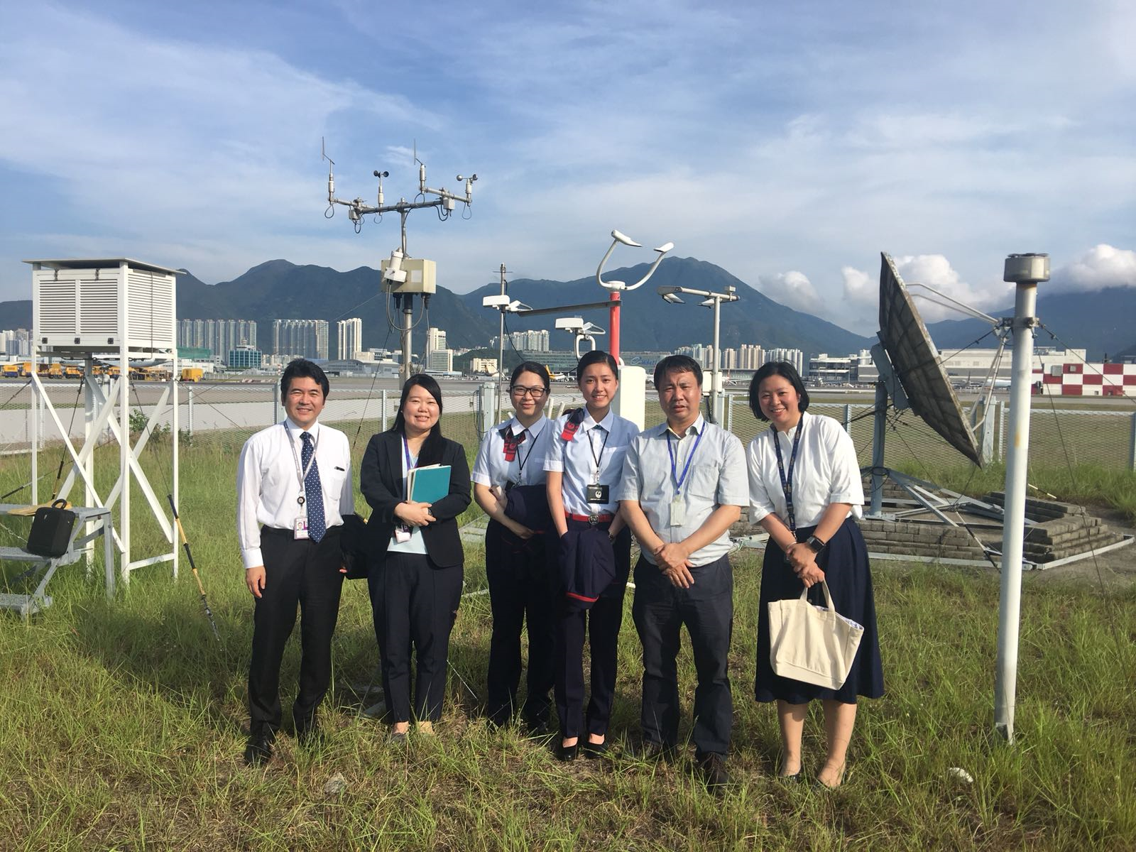 Figure 1: A group photo of visitors from Japan Airlines with the Observatory's Chief Experimental Officer, Mr. PS Ho (second from right) taken in the Meteorological Enclosure