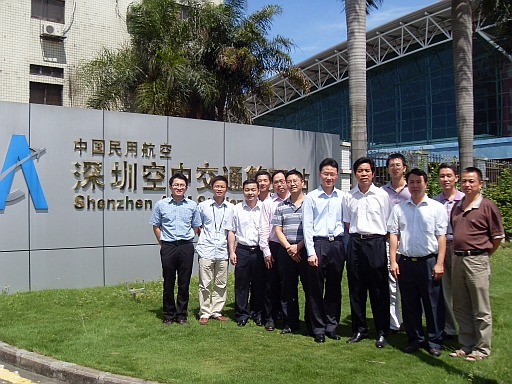 The Observatory's staff taking a photo with the Director of Shenzhen Air Traffic Management Station of CAAC, Mr. Cheng Liangyu (fifth from right) and staff of the Meteorological Station.