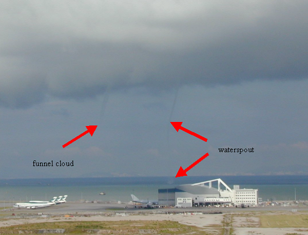 Photograph taken by the Observatory Weather Observer at the airport at 8:02 a.m., 31 July 2003 (Thursday),                                                               looking towards the southwest