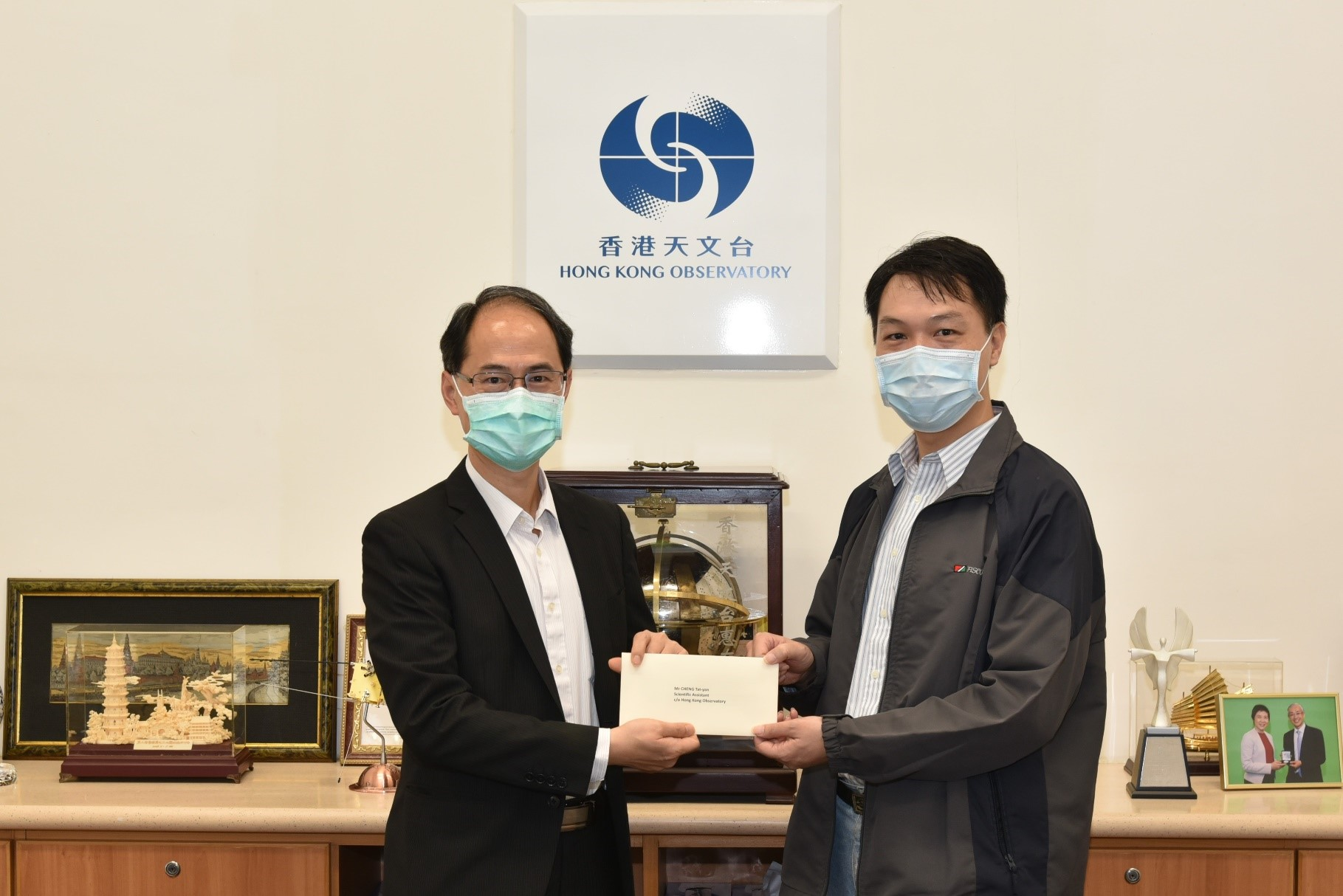 Mr Cheng Tat-yan (right) was promoted to Senior Scientific Assistant
